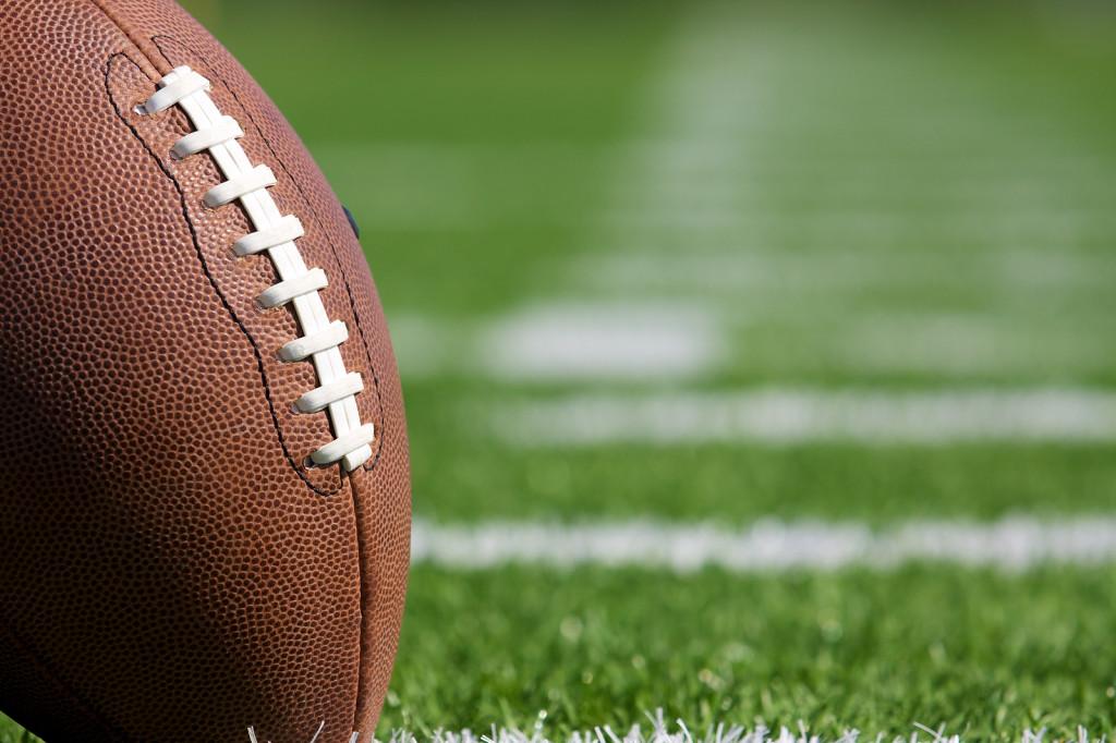 bigstock-Pro-American-Football-on-the-F-26163068