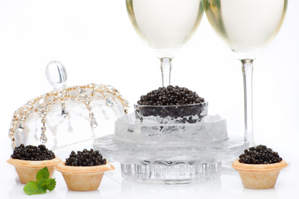 bigstock-Black-caviar-and-champagne-iso-47412103