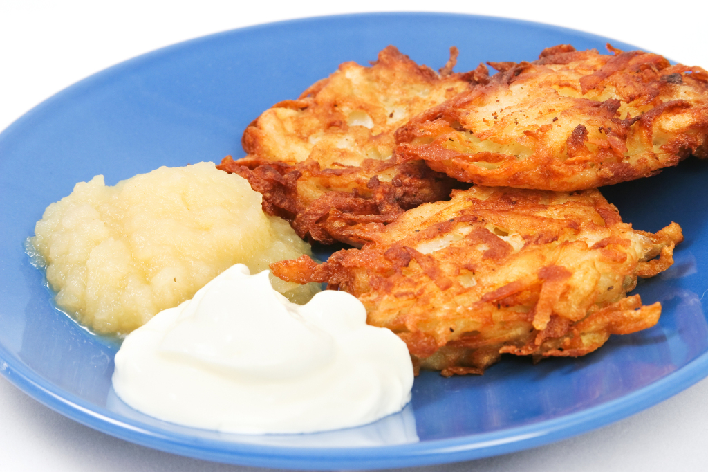 Traditional potato latkes or pancakes for Hanukkah with side of