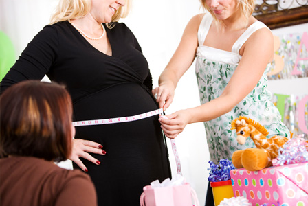 measuring-pregnant-belly-at-baby-shower